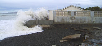 The heavy seas roll into Haumoana homes in July 2006 (Photo HBRC)