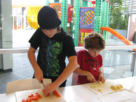 Liam and Ryan Dingle learn some valuable chopping skills at the RMHA school